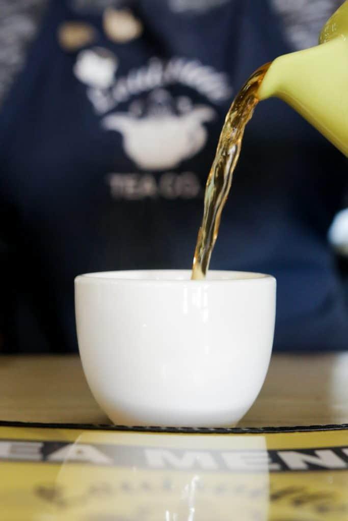 Pouring tea at Louisville Tea co